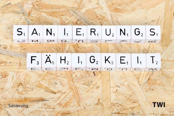 Text Sanierungsfähigkeit mit Buchstabenwürfeln geschrieben